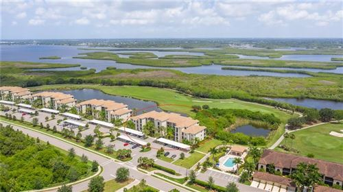 Photo of 7121 RIVER HAMMOCK DRIVE #405, BRADENTON, FL 34212 (MLS # A4468047)