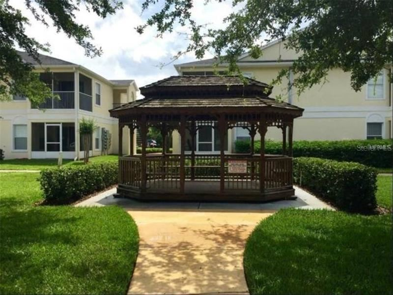 Photo of 8813 GRAND PALMS CIRCLE #A, KISSIMMEE, FL 34747 (MLS # O5918048)