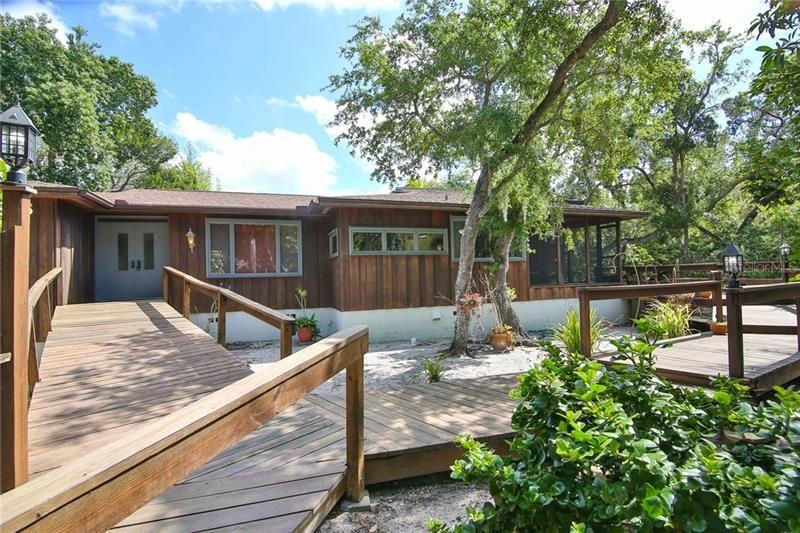 Photo of 1311 ROBERTS BAY LANE, SARASOTA, FL 34242 (MLS # A4497050)