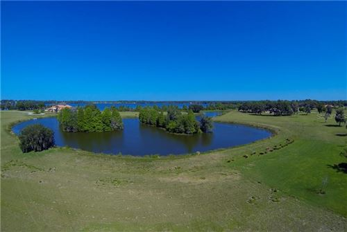 Main image for 10710 OSPREY LANDING LOT 48 WAY, THONOTOSASSA, FL  33592. Photo 1 of 25