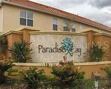 Photo of 5516 PARADISE CAY CIRCLE, KISSIMMEE, FL 34746 (MLS # S5035059)