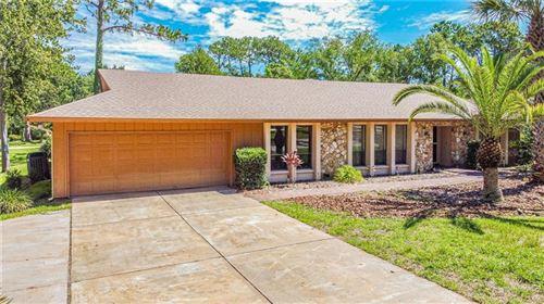 Photo of 302 WILD OLIVE LANE, LONGWOOD, FL 32779 (MLS # O5874072)