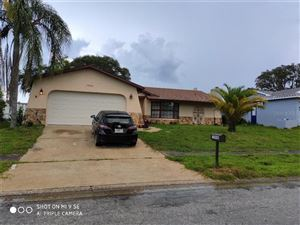 Main image for 10940 PEPPERTREE LANE, PORT RICHEY, FL  34668. Photo 1 of 14