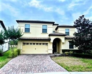 Photo of 1478 MOON VALLEY DRIVE, CHAMPIONS GATE, FL 33896 (MLS # O5953082)