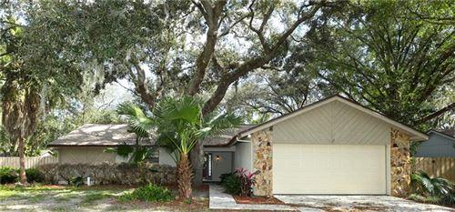 Photo of 14921 NORTHWOOD VILLAGE LANE, TAMPA, FL 33613 (MLS # U8099092)