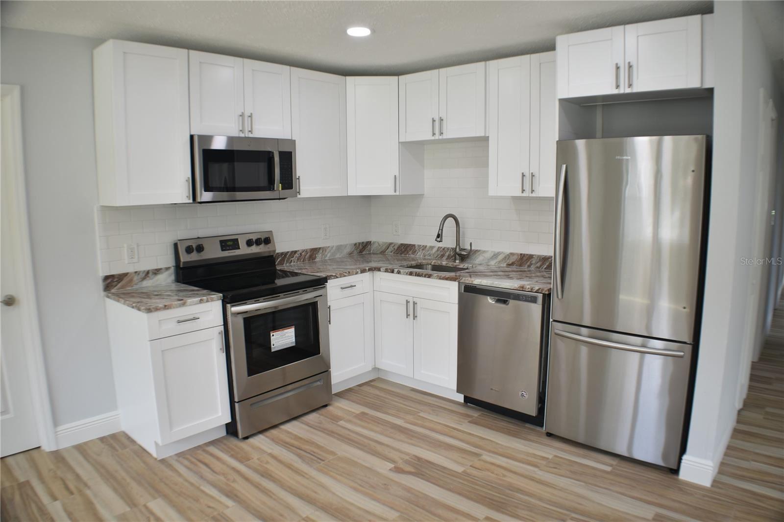 Photo of 116 EMERALD LANE, LARGO, FL 33771 (MLS # U8132097)
