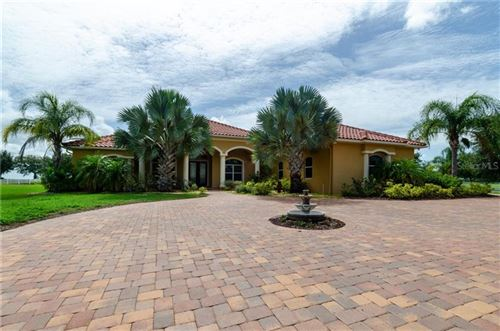 Photo of 5904 LAKE PADDOCK CIRCLE, PARRISH, FL 34219 (MLS # A4474101)