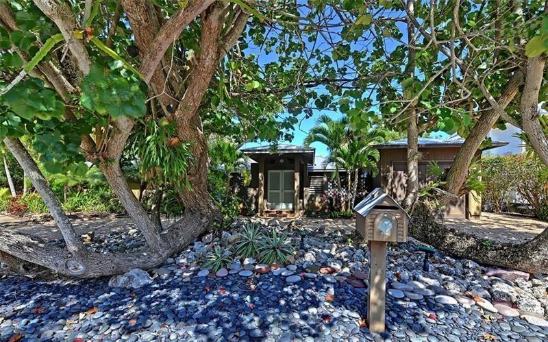 Photo of 673 DREAM ISLAND ROAD, LONGBOAT KEY, FL 34228 (MLS # A4461108)