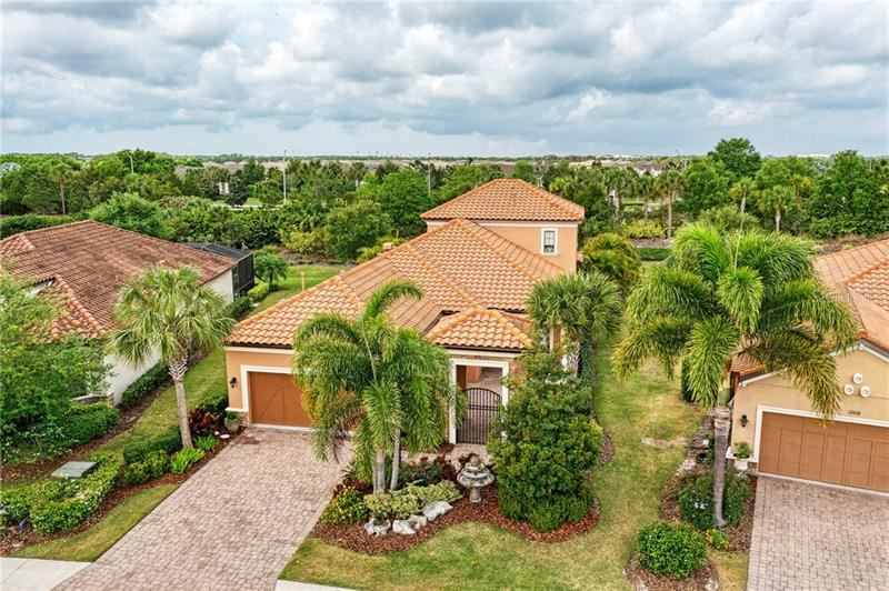 Photo of 12672 FONTANA LOOP, LAKEWOOD RANCH, FL 34211 (MLS # A4496111)
