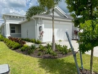 Photo of 207 VAN GOGH COVE, BRADENTON, FL 34212 (MLS # A4474112)