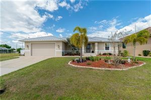 Photo of 132 PECKHAM ST SE, PORT CHARLOTTE, FL 33952 (MLS # C7414117)
