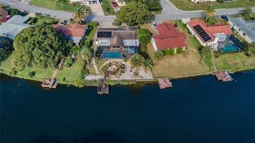 Photo of 9416 LAKE CHRISTINA LANE, PORT RICHEY, FL 34668 (MLS # W7839117)