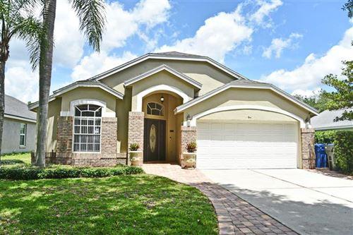 Photo of 941 N LAKE CLAIRE CIRCLE, OVIEDO, FL 32765 (MLS # O5940118)