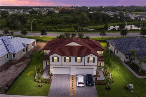Photo of 2433 WILDFLOWER RUN, LAKEWOOD RANCH, FL 34211 (MLS # A4479119)
