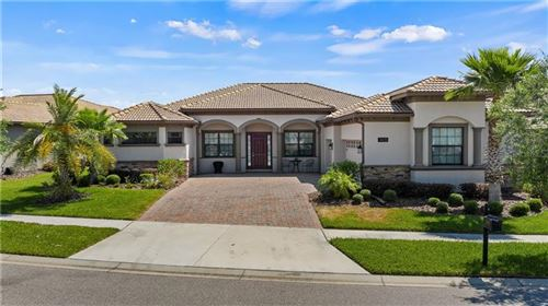 Photo of 1405 MICKELSON COURT, CHAMPIONS GATE, FL 33896 (MLS # O5937130)