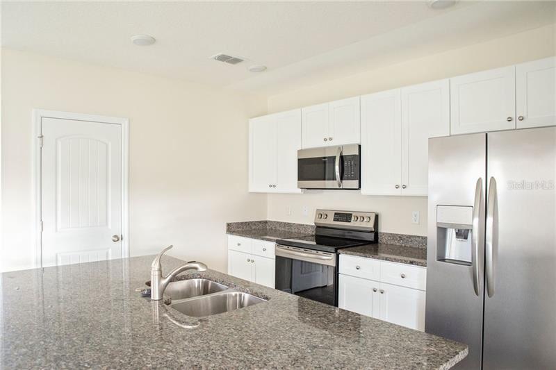Photo of 9849 CLEAR CLOUD ALLEY, WINTER GARDEN, FL 34787 (MLS # O5907132)
