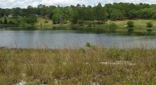 Photo of ORANGE CIRCLE, LADY LAKE, FL 32159 (MLS # O5945134)