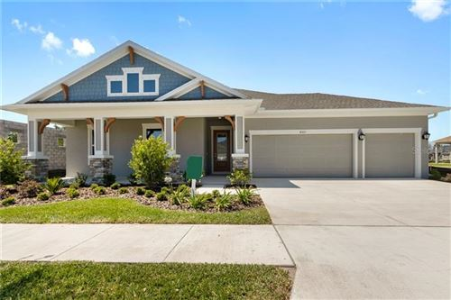 Photo of 4521 TOUR TRACE, LAND O LAKES, FL 34638 (MLS # T3221135)