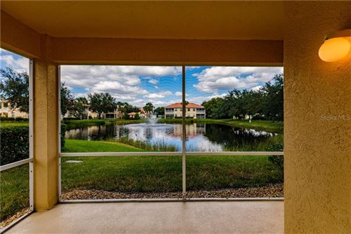Photo of 101 CASA DEL LAGO WAY #101, VENICE, FL 34292 (MLS # N6108154)