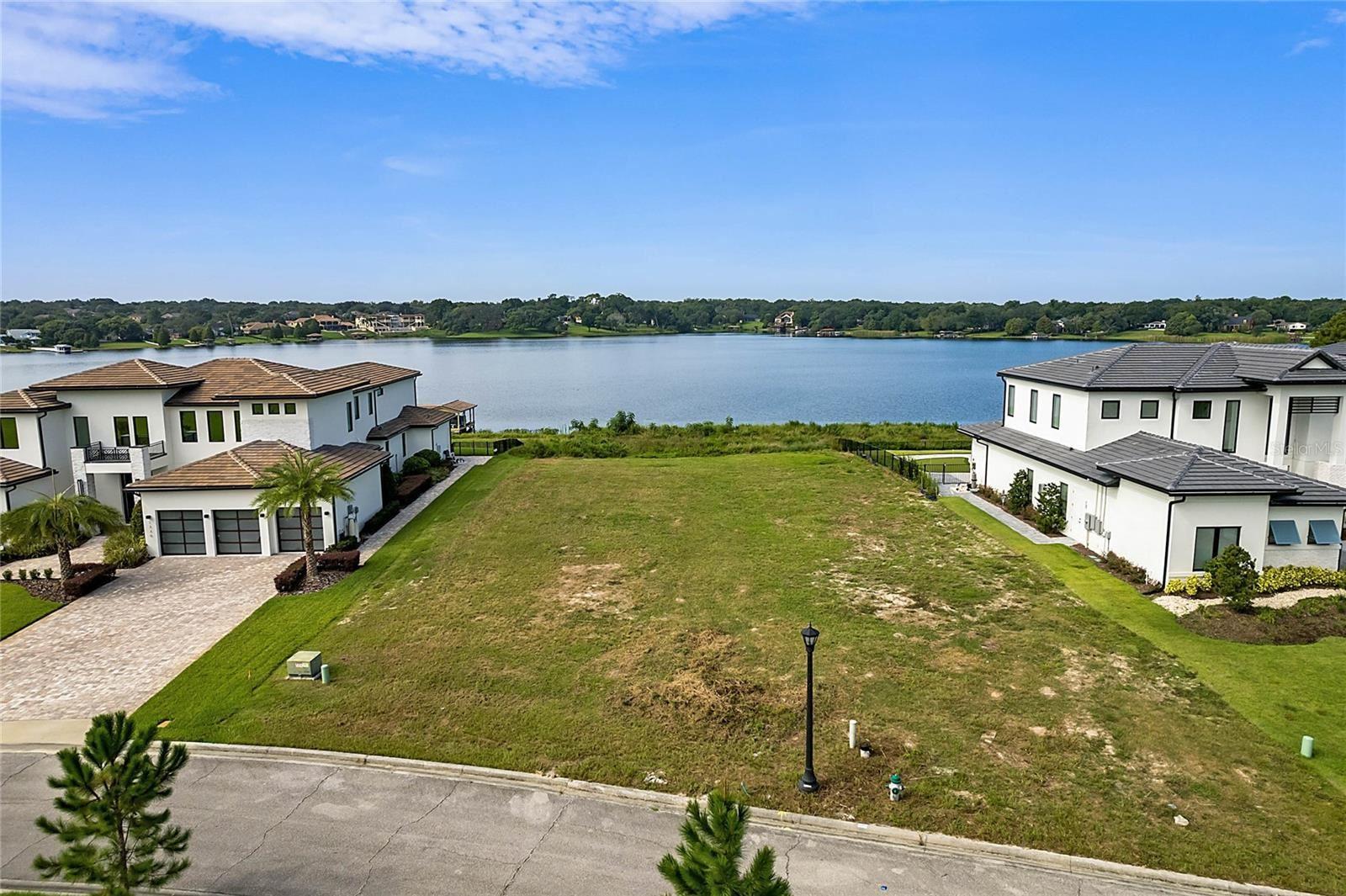 Photo of 1330 LAKE OLIVIA LANE, WINDERMERE, FL 34786 (MLS # O5970174)