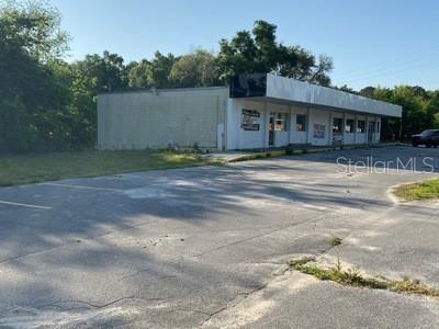 Photo of 11 NE 58TH AVENUE, OCALA, FL 34470 (MLS # OM618178)