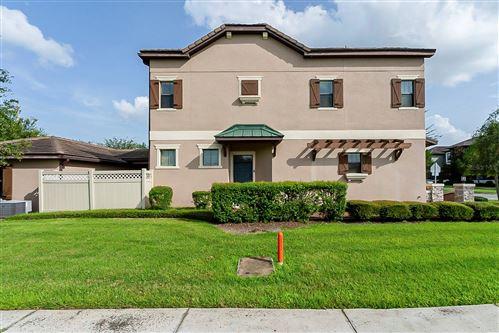 Photo of 10603 VILLAGE LAKE ROAD, WINDERMERE, FL 34786 (MLS # O5953182)