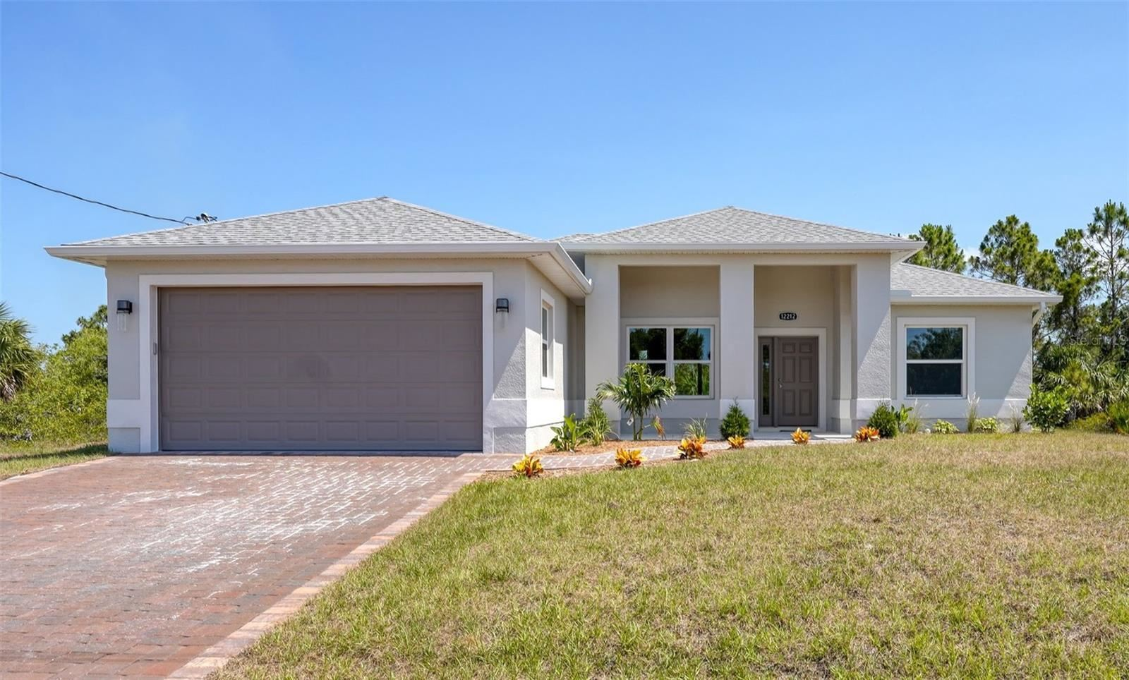 Photo of 7410 ELLIS LANE, PORT CHARLOTTE, FL 33981 (MLS # D6120184)