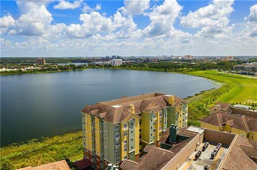 Photo of 8743 THE ESPLANADE #37, ORLANDO, FL 32836 (MLS # O5875195)