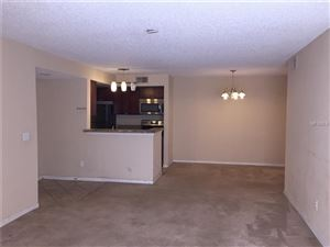 Photo of 5144 CONROY RD #28, ORLANDO, FL 32811 (MLS # O5555198)