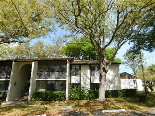 Photo of 1708 PINE RIDGE WAY E #D, PALM HARBOR, FL 34684 (MLS # U8078198)