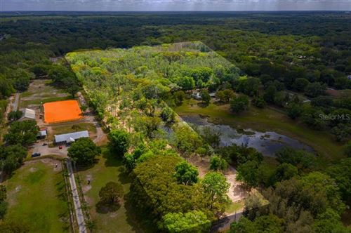 Main image for 710 DUQUE ROAD, LUTZ,FL33549. Photo 1 of 27