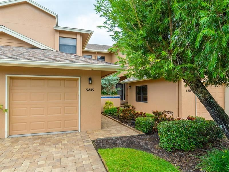 Photo of 5235 HERON WAY #101, SARASOTA, FL 34231 (MLS # A4478204)