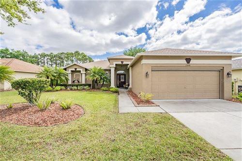 Photo of 1446 MORNING ROSE PLACE, TRINITY, FL 34655 (MLS # W7832208)