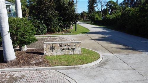 Photo of 6825 PORTSIDE LANE, ENGLEWOOD, FL 34223 (MLS # D6121212)