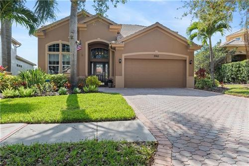 Photo of 9965 SAGO POINT DRIVE, SEMINOLE, FL 33777 (MLS # U8075212)