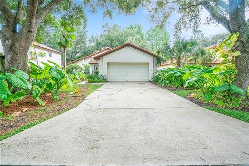Photo of 6543 DOUBLETRACE LANE, ORLANDO, FL 32819 (MLS # O5856213)