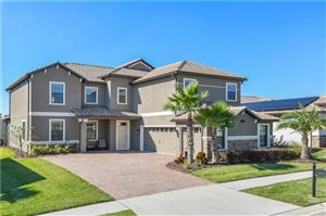 Photo of 1412 MICKELSON COURT, CHAMPIONS GATE, FL 33896 (MLS # O5748224)