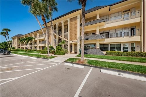 Photo of 4700 COVE CIRCLE #102, ST PETERSBURG, FL 33708 (MLS # U8101228)