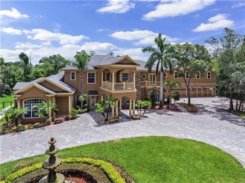 Photo of 5649 N DEAN ROAD, ORLANDO, FL 32817 (MLS # O5876231)