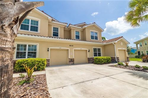 Photo of 8140 ENCLAVE WAY #102, SARASOTA, FL 34243 (MLS # A4473232)