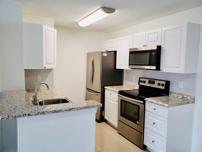 Photo of 2030 CASCADES BOULEVARD #206, KISSIMMEE, FL 34741 (MLS # O5883232)