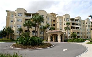 Photo of 8495 MIRACLE DRIVE #503, CHAMPIONS GATE, FL 33896 (MLS # O5806234)