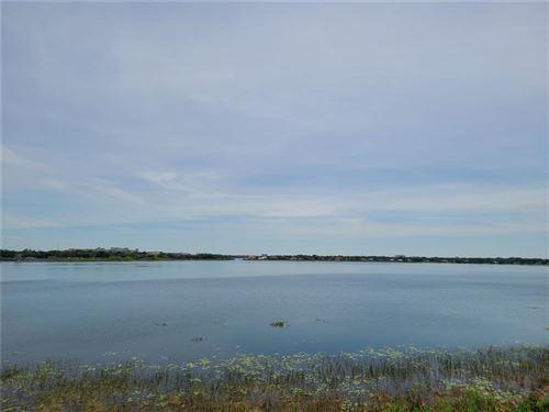 Photo of 8749 THE ESPLANADE #9, ORLANDO, FL 32836 (MLS # O5942236)