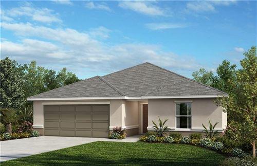 Photo of 13748 RUSHING CREEK RUN, ORLANDO, FL 32824 (MLS # O5854242)