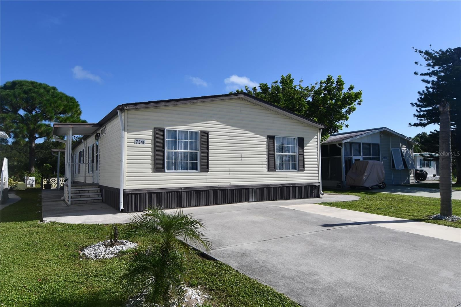 Photo of 7341 SWINTON AVENUE, PORT CHARLOTTE, FL 33981 (MLS # C7427243)
