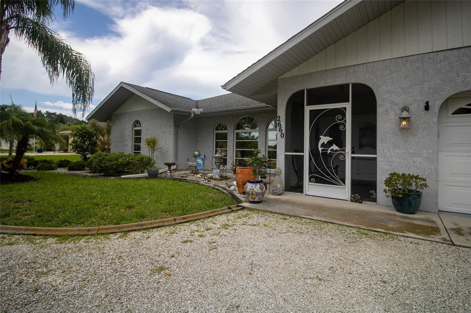 Photo of 2660 ALAMANDER AVENUE, ENGLEWOOD, FL 34223 (MLS # D6120250)