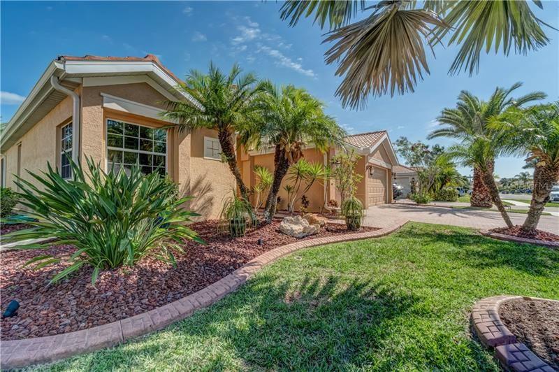 Photo of 11907 GRANITE WOODS LOOP, VENICE, FL 34292 (MLS # N6110250)