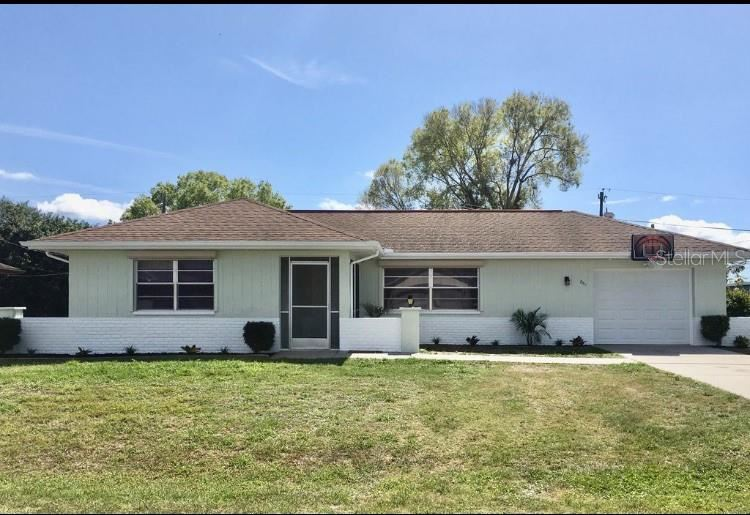 Photo of 861 SILVER SPRINGS TERRACE NW, PORT CHARLOTTE, FL 33948 (MLS # C7428259)
