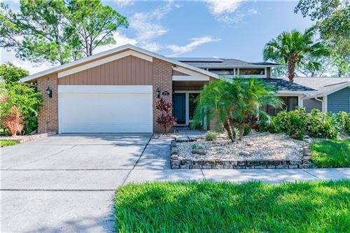 Photo of 14672 VILLAGE GLEN CIRCLE, TAMPA, FL 33618 (MLS # U8094264)