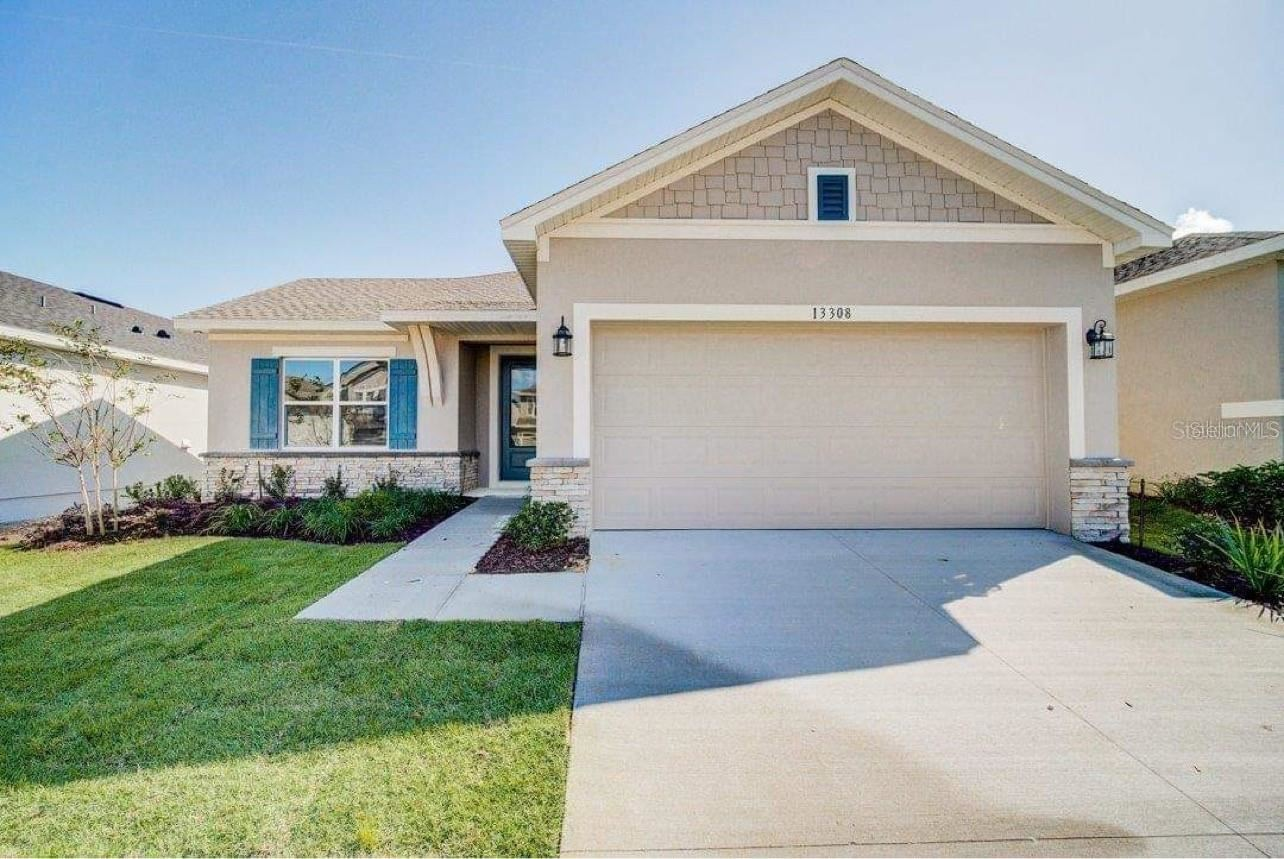 Photo of 13308 MAGNOLIA VALLEY DRIVE, CLERMONT, FL 34711 (MLS # O5975279)